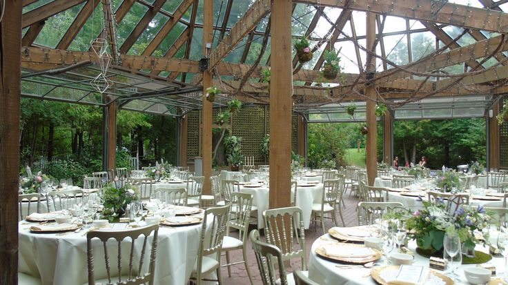 Beautiful reception in the Glass House with stunning rental chairs