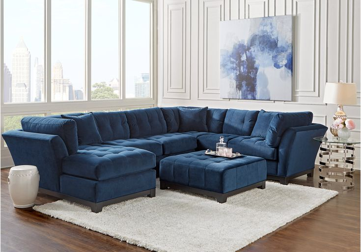 Cindy Crawford Home Metropolis Navy 4 Pc Sectional Living Room.2399.99.  Find affordable Living Room Sets for your home that will complement the rest of your furniture. #iSofa #roomstogo