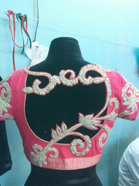 Embroidered cut work motif on the back