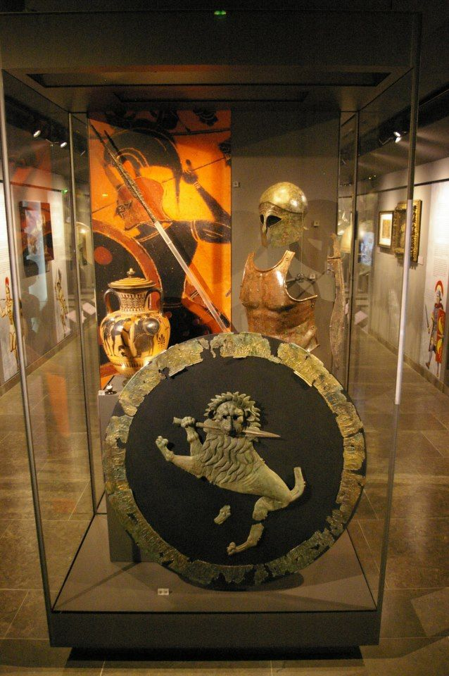 Ancient Greek aspis shield, muscle cuirass, Corinthian helmet, dory spear and kopis sword.