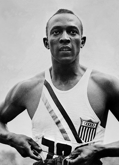 Track-and-field athlete Jesse Owens's four Olympic gold medals in 1936 undermining Hitler's demonstration of Aryan superiority.