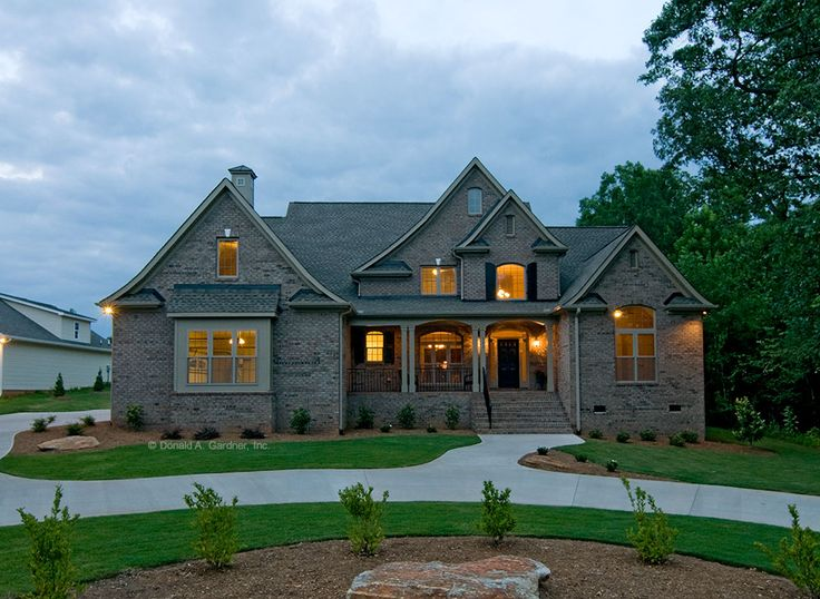 Two Story Brick Home With European Style Exterior Evening