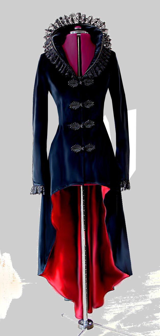 +*Ein einzigartiger zauberhafter Mantel aus rabenschwarzem Baumwollsamt für den großen Auftritt*+   Mit dem im Oberteil figurbetonten Schnitt und der zum Mantelsaum hin wunderschön schwingenden...