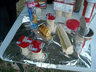 we call this campfire yummy WOPPITS and use large canned biscuits.(Not flaky)  place on a oiled wooden dowel (premade) bake over hot coals till able to slide off. Fill hollow middle with ANYTHING yummy! chocolate chips, pudding, and more. or scrambled eggs, ham, cheese, hot dogs... ENJOY!