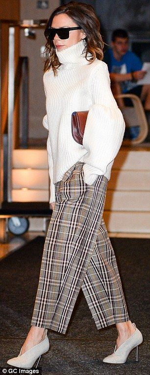 Sleek and chic: Victoria Beckham, 42, paired her plaid pants with a chunky knit turtleneck, stylish sunnies and sky-high stilettos