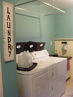 laundry room idea... I like the baskets and how clean it is.... doing :-)