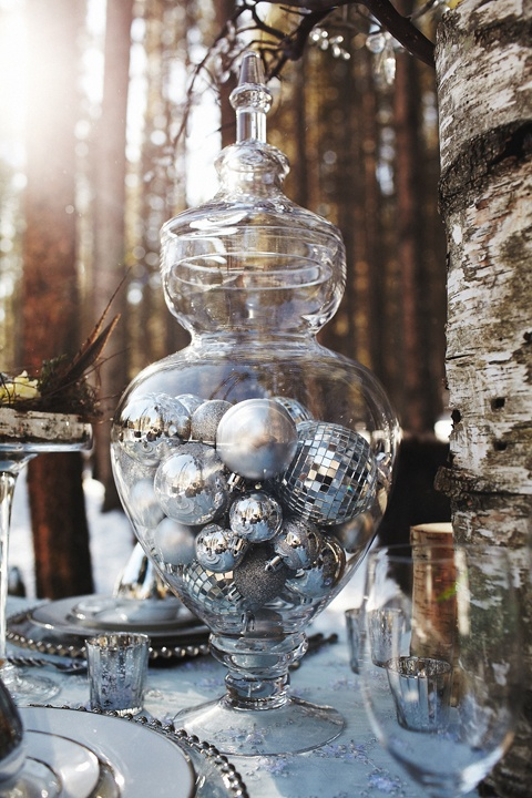 Fill an apothecary jar with silver balls.  This decor is a great accent to black and adds some POP to a centerpiece.  www.celebrationsbykat.com: