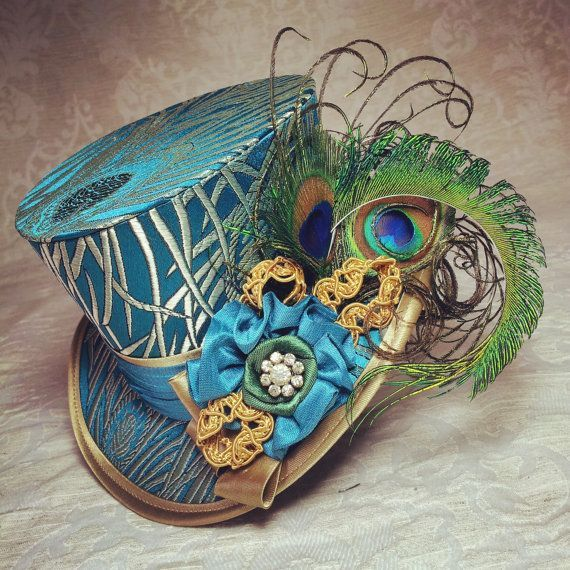 4 top hat - Steampunk hat, Bridal hat, Dieselpunk hat, Wedding hat, Burlesque hat, Retro hat, Hollywood Glamour, Vintage hat, Victorian hat, Art Deco style, Alternative, Kitsch, Offbeat, pure silk - handmade mini top hat called Vintage Peacock  Covered in stunning silk brocade, embroidered with stylised peacock feathers in turquoise, blue and gold. The hat is delicately decorated with handmade rosettes in gorgeous turquoise silk, gold trim and green satin ribbon roses. Finally, trimmed with…