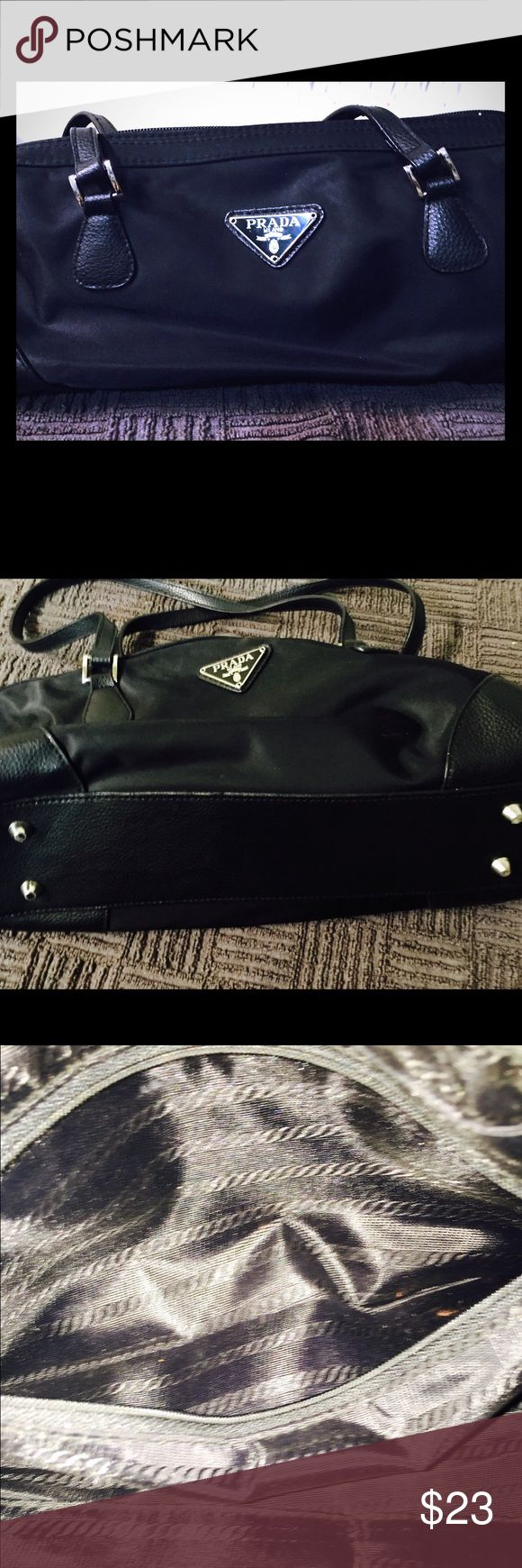 ❌NON Authentic Prada Purse❌ ❌NON AUTHENTIC PRADA PURSE❌. Condition is brand new and never used. You would have a hard time telling its not a real Prada Purse unless you were a Prada Expert. The purse looks exactly like the real thing and normal everyday people could not tell the difference. It has a double handle, zip closure, inside zip pocket and Prada emblem on the front. If I did know when bought from a purse party I swear it was the real thing, especially given the cost I paid for it…
