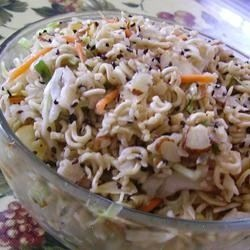 an overnight salad using ramen noodles, cabbage, chicken, almonds, and green onions.