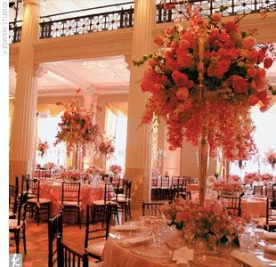 With the church an easy choice for the ceremony, the group picked The Corinthian, a renovated bank with stone columns, for a pink-and-white reception party. The modern reception was decorated with round and rectangular tables covered with strawberry taffe...