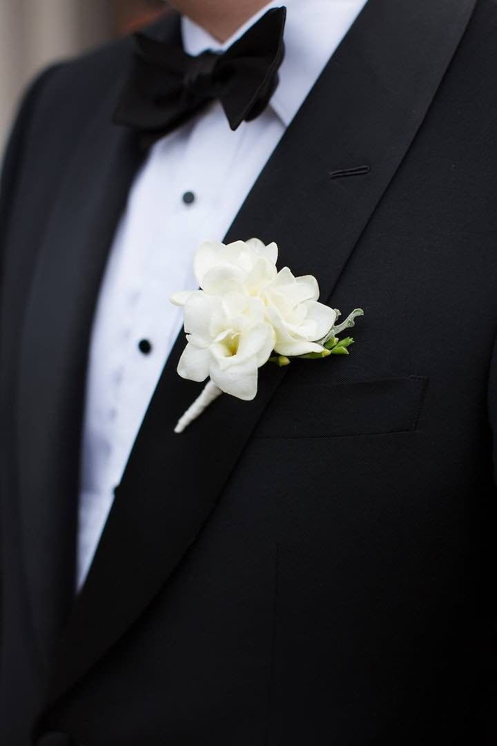 elegant wedding boutonniere; Photo: Sarah Kate Photography