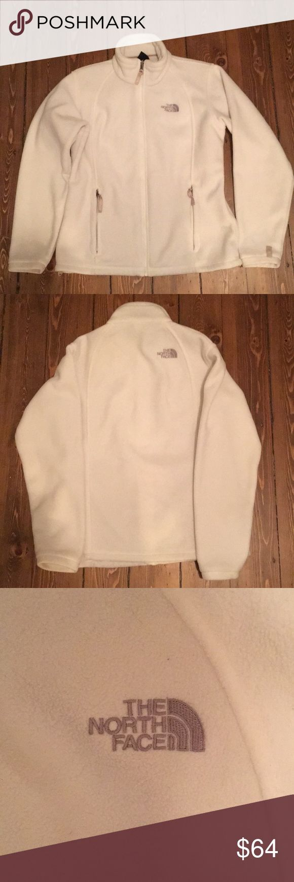 """The North Face White Fleece Zip Up Stay stylish and warm this winter! Wonderful all white North Face zip up fleece jacket. Has beige zipper pulls and beige detail along the zipper. 2 Large side zipper pockets. Gray """"The North Face"""" lettering. 100% polyester. Size L. Worn a bunch but in great shape! No rips or stains. Fleece is still pretty soft. Happy shopping! The North Face Jackets & Coats"""