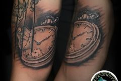 Clock tattoo with tattoo joker is a great combination for your sleeve tattoo.