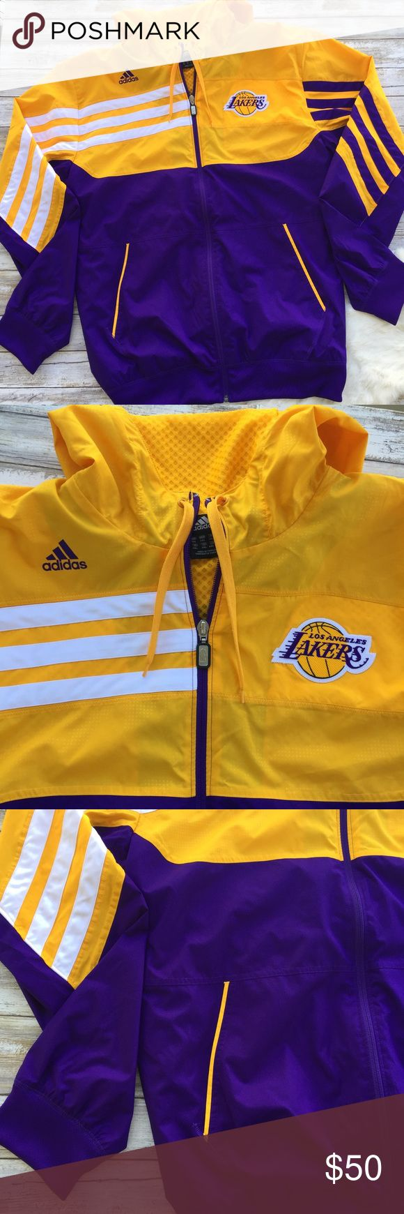 """Adidas L.A. Lakers Windbreaker Lined Windbreaker from Adidas. NBA Los Angels Lakers. Size 2XL. 26""""chest 29.5"""" sleeves32"""" length.  •I don't swap/trade •I don't do holds  •I rarely model due to the fact that I don't fit all items.  •I price with shipping in mind  •I am open to reasonable negotiations  •Bundle for the best deals  ☮   ❤️   😊 adidas Jackets & Coats Windbreakers"""