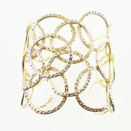 Gold cirlce cuff  by Beryl Dingemans