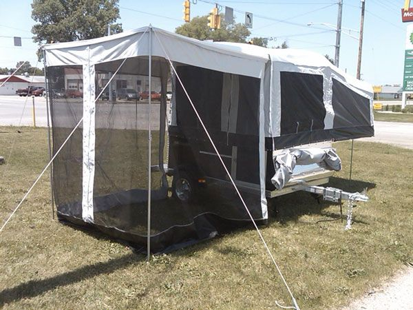quicksilver livin lite pop up camper with awning and enclosure