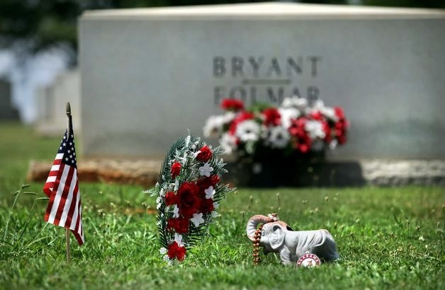 "Alabama Coach Paul ""Bear"" Bryant's grave is adorned with a flag, an elephant, and an Alabama emblem. He is burried in Birmingham in the Elmwood Cemetery and Mausoleum. The Texas A Aggies, new to the Southeastern Conference, will travel to Auburn, Alabama, Mississippi State and Ole Miss this year. Monday, July 23, 2012. Photo: BOB OWEN, San Antonio Express-News / © 2012 San Antonio Express-News"