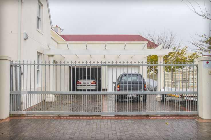 Motorised gate giving access to this property's garage and parking area.