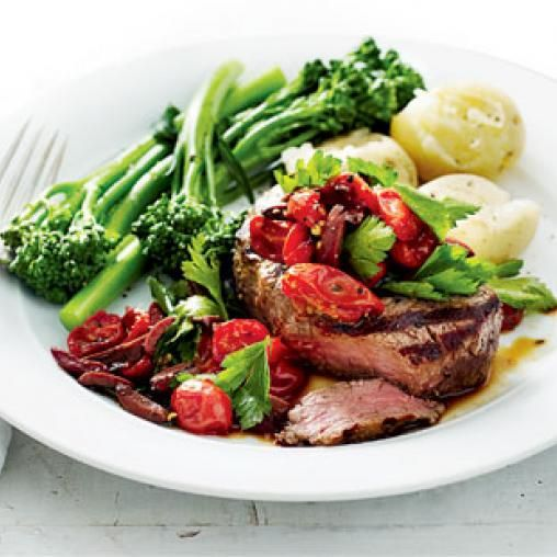 Steak with tomato, olive and parsley relish