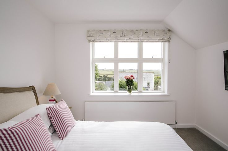 The bedrooms at 1 The Sands are modern and beautifully decorated. Enjoy countryside views from this double bedroom of the self-catering holiday home in Polzeath, North Cornwall.