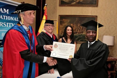 Antonio José Ernesto Ngunza at the 2014 Madrid Graduation. Antonio José Ernesto Ngunza receiving his degree from Prof. William Martin, BIU CEO.