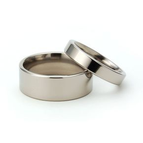 New His And Hers Wedding Band Set - Titanium Rings. $49.99, via Etsy.