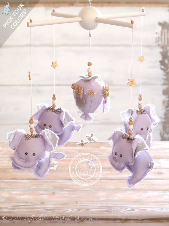 Here I show you an original Elephant Baby Nursery Mobile designed by Lolly Cloth and handcrafted in shades of light lavender and grey: four baby