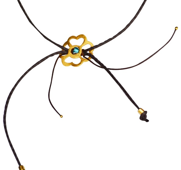 """Bracelet """"Dahlia""""   Leather necklace, with a gold plated 925 silver element, in an flower shape."""
