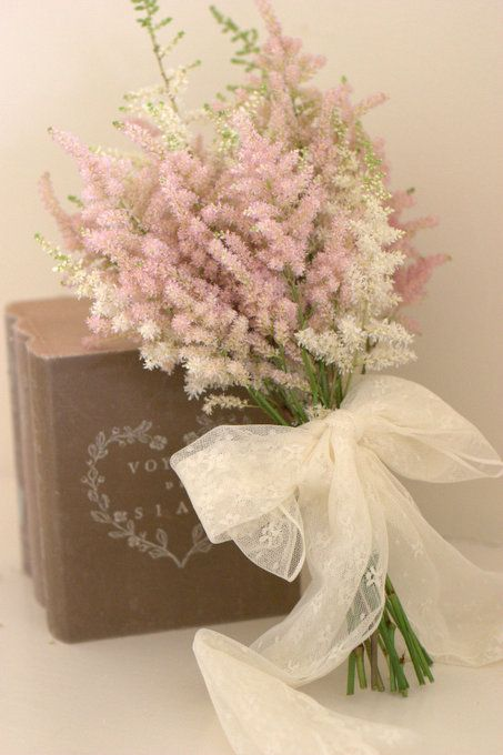 vintage books and lace for wedding tables Astilbe wedding bouquet soft pastel pink fluffy florals & lace bound bouquet. Created by Blush Rose Manchester wedding florist.
