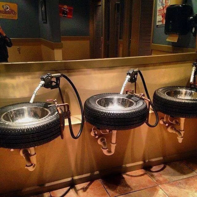 Repurposed old tires into sink, restroom bathroom sinks; gas pump handle for water; Upcycle, Recycle, Salvage, diy, thrift, flea, repurpose, refashion! For vintage ideas and goods shop at Estate ReSale & ReDesign, Bonita Springs, FL