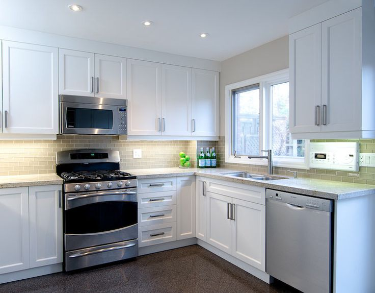 L Shaped Kitchen Features White Cabinets Paired With