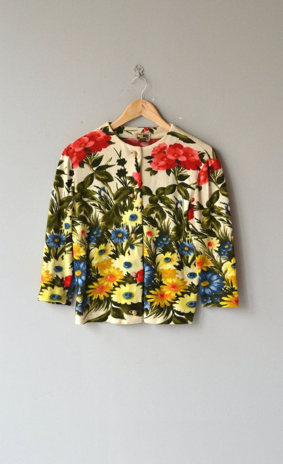 Vintage 1950s, early 1960s wool cardigan with exciting and colorful floral print, 3/4 sleeves and rounded wooden buttons. --- M E A S U R E M E N T S
