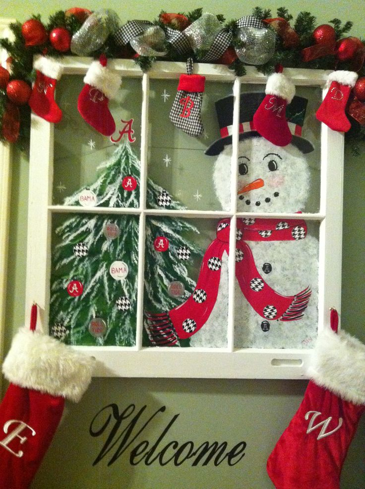 A way to customize a window for the holidays --a valance of Cmas stockings  or hang on lower hooks