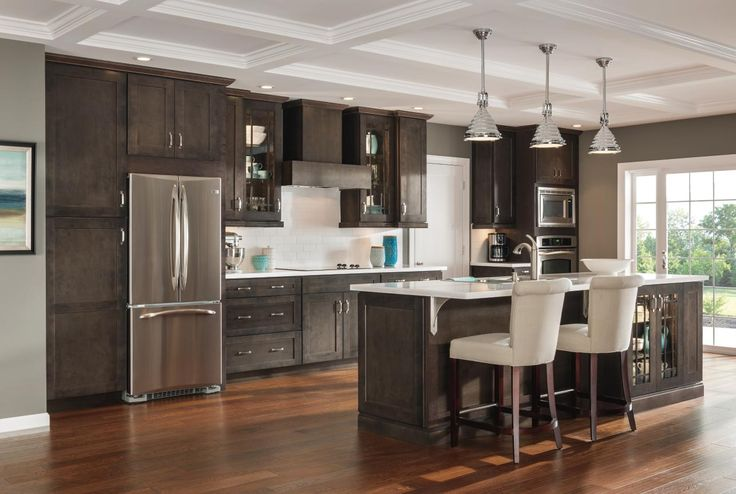 The open floor plan and expansive island in this for Aristocraft kitchen cabinets
