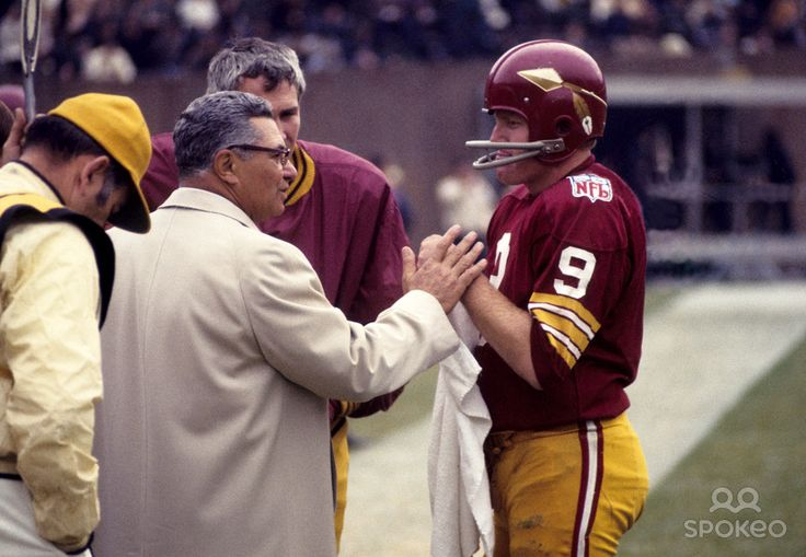 Washington Redskins quarterback #9 Sonny Jurgensen threw for 32,224 yards and 255 touchdowns during his 18 seasons in the NFL.  Note coach Vince Lombardi of Packer lore and the old style 'Skins unis.
