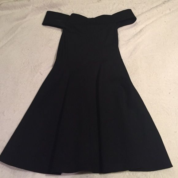 Off Shoulder Black Dress FOR 2 WEEKS ONLY-- ONLY ON SALE TILL 12/29. I'm at home for the holidays and this is in my NY closet. Once I return back to California I won't have this in my possession-- selling this beautiful black off shoulder dress. I wore this to a wedding with those purple heels I've also listed. This has a silver zipper that goes halfway down the back. Material is 60% cotton, 33% polyamide and 7% spandex. I love how the bottom flares out a bit and isn't tight on the legs…