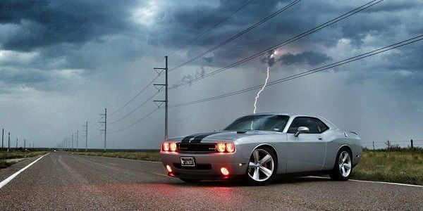 No, this lightning strike wasn't edited into the picture of this 2010 Dodge Challenger SRT8