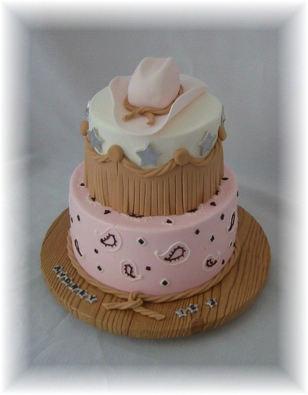 """Cowgirl Hat and Bandana - I made this cake in 2006, but neglected to post it here.  It's kinda fun because if you do an internet search for """"cowgirl cakes"""", several variations of this cake will come up.  How cool is that??  Iced in buttercream with fondant hat and accents."""