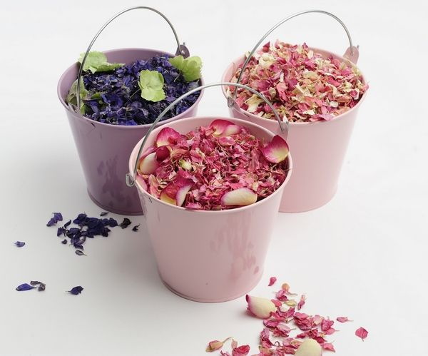 A little bucket of wedding confetti flower petals - lovely could imagine a cream bucket with lavender flower for confetti #lavenderweddingconfetti
