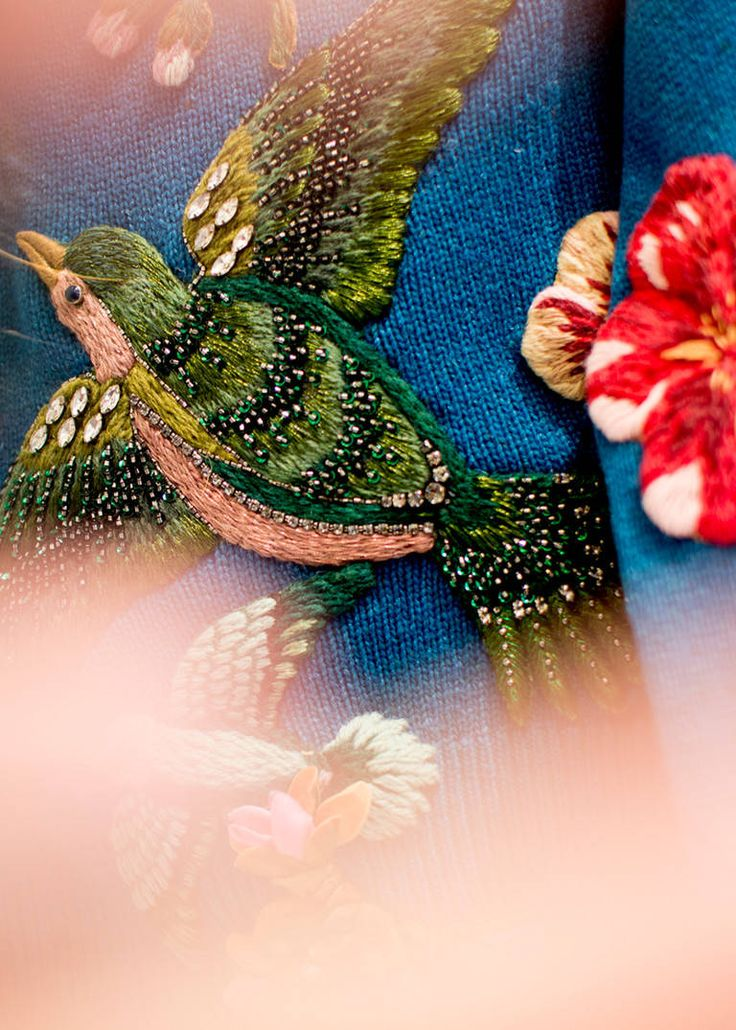 Gucci Embroidery: From a swallow in mid-flight on the bodice of a dress to a serpent snaking up the side of a sweater, hand-embroidered appliqués appear throughout the Fall Winter 2015 collection.