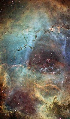The radiation from 2,500 young stars excites the atoms causing them to emit radiation themselves. This view of the very center of the Rosette Nebula spans 15 light years across. Credit: NASA/ESA Hubble Space Telescope