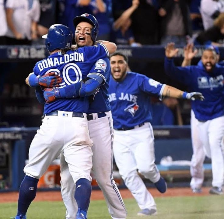 Toronnto Blue Jays Josh Donaldson and Troy Tulowitzki hug in celebration after Donaldson scores the ALDS-series winning run in extra innings on an error by Texas Rangers second baseman Rougned Odor. And Dioner Navarro is close behind. LOL. MLB. Baseball. 2016 postseason.