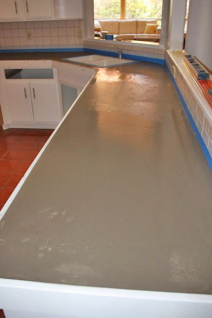 Concrete countertops by covering the existing then saint seal!