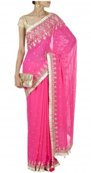 Featuring a neon red georgette saree, delicately embroidered with gotta patti work on the border.