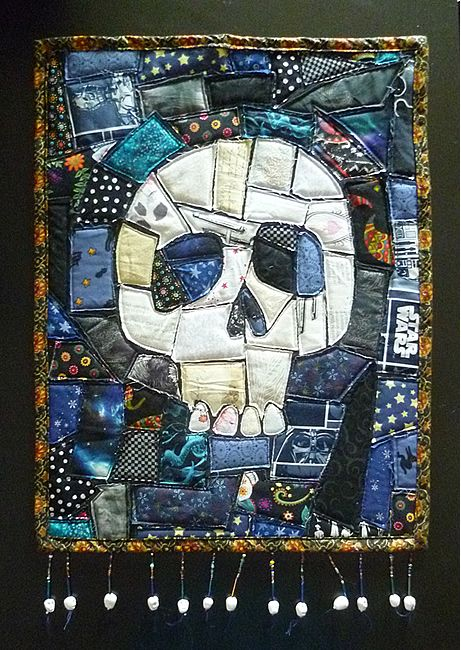 """Ticker Tape Skulls Art Quilt! - very cute!! A ticker tape or """"mosaic"""" quilt."""