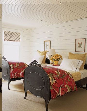 Allso look a white(creamy yellow base) darker camel pillows bedding mixes the red and camel with dark wood bed end