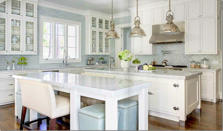 white cabinets. soft blue subway tile backsplash to ceiling