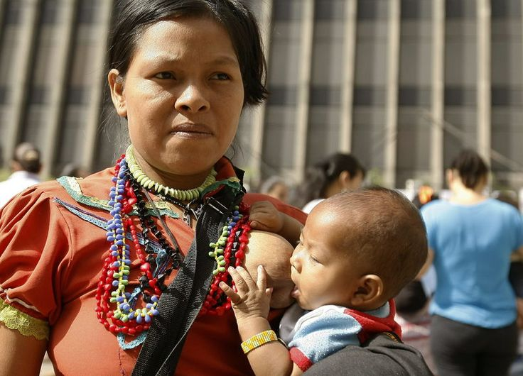 "COLOMBIA: An indigenous woman from the Emberá Katío community breastfeeds her son during Medellin's event for the global ""Big Latch On"" event, July 31, 2015. Photo:EFE"
