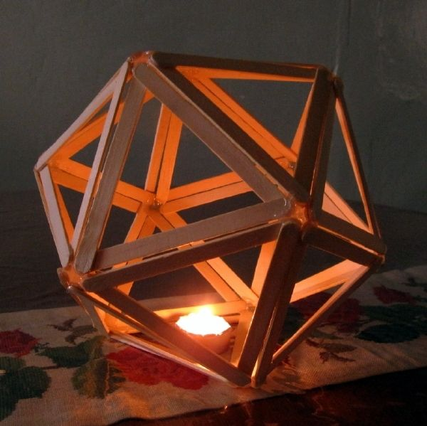 What is an Icosahedron?  In geometry, an icosahedron is a regular polyhedron with 20 identical equilateral triangular faces, 30 edges and 12 vertices...